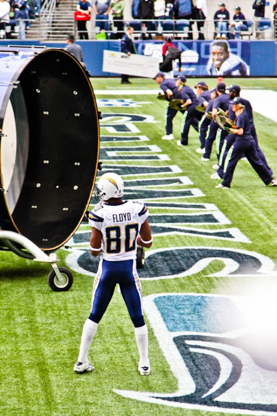 """Malcom Flyod with te Seahawks """"Blue Thunder Band"""" in the back."""