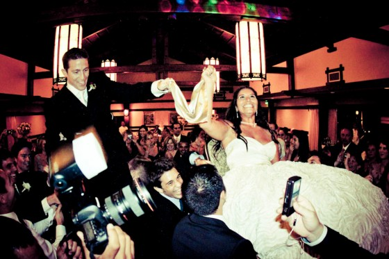 My first witness of the tossing the bride and groom on chairs! Looks like fun!