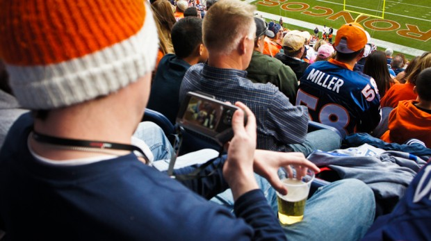 So at Denver (and Seattle) football games, you can rent out this little game gear resembling thing that you can watch replays from the game or even look at box scores from other games. Oh how we need a new stadium badly.